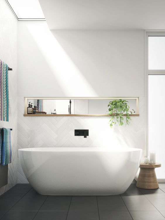 a white bathing space done with a skylight over it - a lovely idea to get natural light while keeping privacy