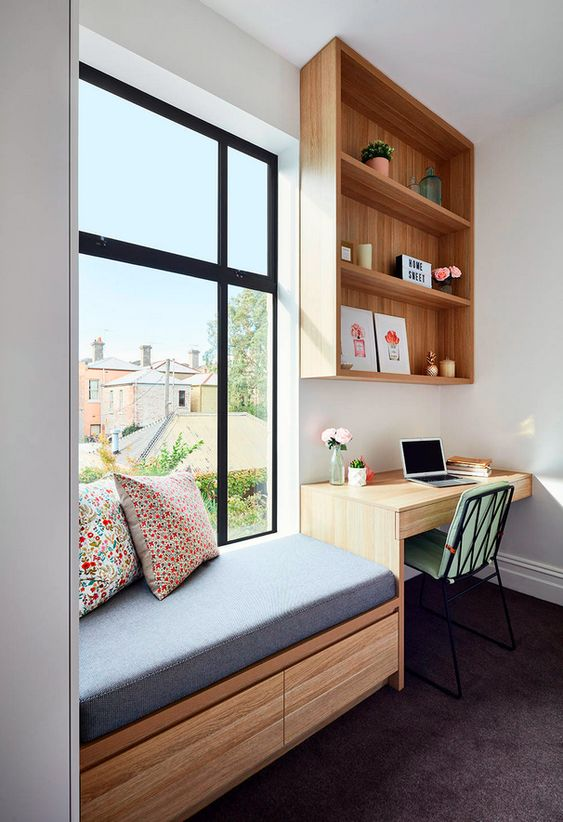 a windowsill daybed with an upholstered bench and colorful pillows plus a study space next to it look contemporary and fresh