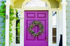 accent your entrance with a bold purple front door to make a statement with the color, even if the design of the door is very simple