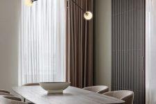 a modern neutral minimalist dining room design