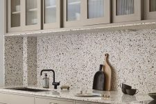 a neutral kitchen design with terrazzo elements