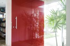 an oversized bold red super sleek front door with a usual handle is a fantastic idea for a mid-century modern home