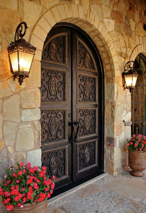dark vintage-styled wrought iron front doors are perfect for a mansion or a large vintage house as they make a refined statement at once