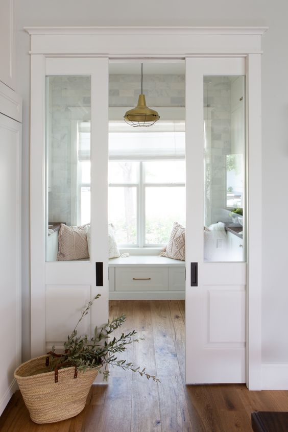 elegant white and glass pocket doors are ideal for separating spaces with style and still let a lot of light in
