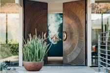 fantastic oversized metal front doors with a pattern is a gorgeous solution for a mid-century modern or modern house