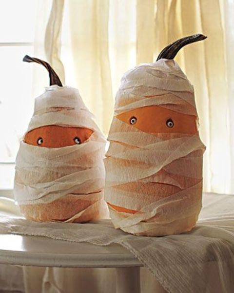 fun gourds styled as mummies with googly eyes are a cool craft for a kids' Halloween party and you cna make them together