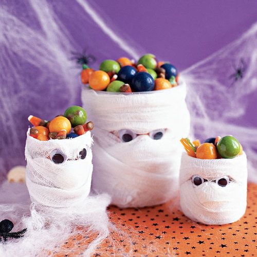 jars shaped as mummies with candies are perfect for kids' Halloween parties are amazing to rock and can be easily DIYed