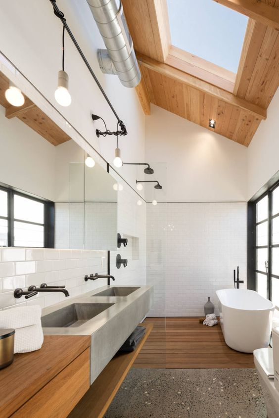 large skylights here keep the bathroom private and personal while filling it with light