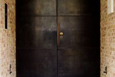 such blackened steel front doors are amazing as they make a statement with their look and keep your home safe – it's hard to break in through them