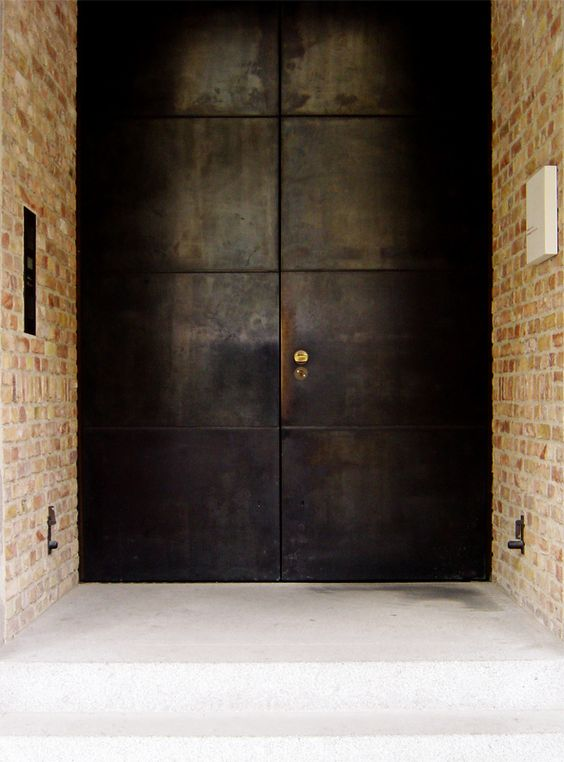 such blackened steel front doors are amazing as they make a statement with their look and keep your home safe - it's hard to break in through them