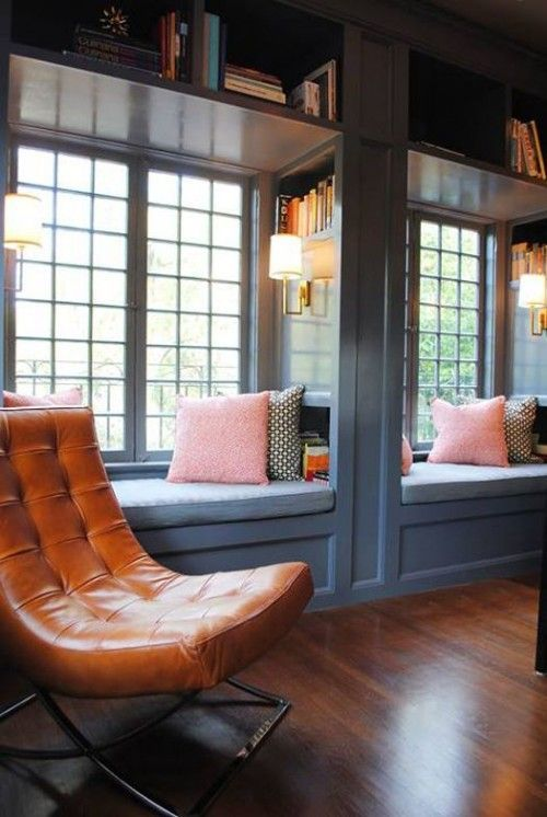 two cozy reading or just sitting nooks at the windows with bookshelves on the walls and over them are perfect