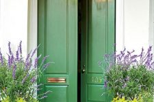 vintage doors made eye-catchy with just green paint and soem gold detailing are a great example of how to refresh your old doors