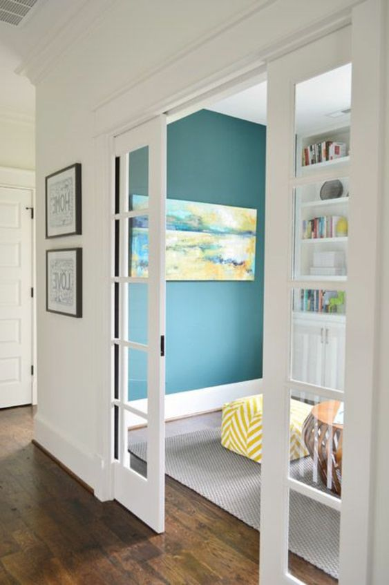 white French pocket doors are a stylish solution to separate the space and do it in a delicate way without heavy looks