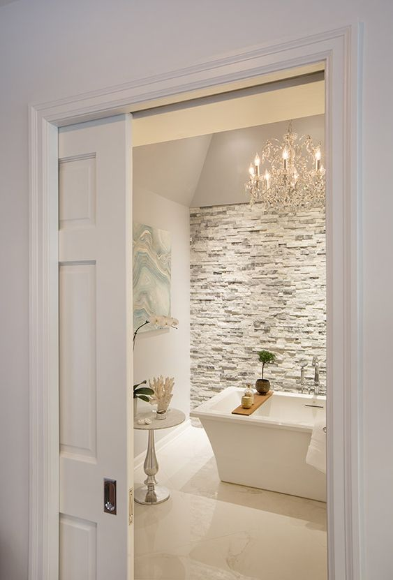 white paned pocket doors are ideal for a modern farmhouse home, they don't take room and look rather lightweight