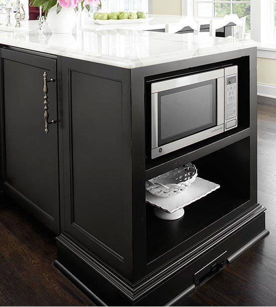 kitchen island with a microwave in