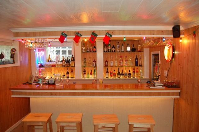 light-colored wood basement bar