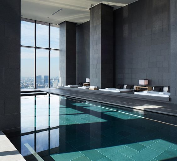 minimalist pool pavillion with stunning big city views