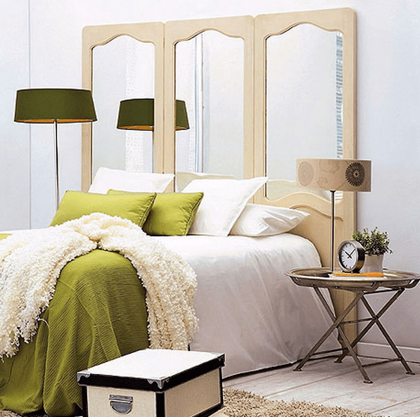 using mirrors as headboards is a great way to add mirrors to your bedroom's interior