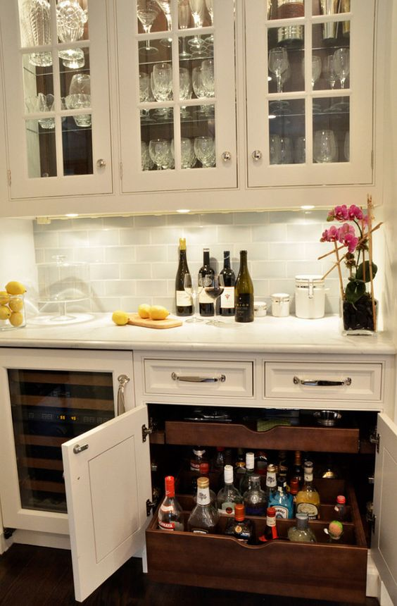 basement bar with custom pull-out drawers