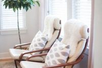 22 white Poang chair with printed cushions and fur covers