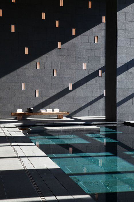 spa-like indoor pool with extensive glazing