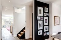 24 black accent wall with pictures