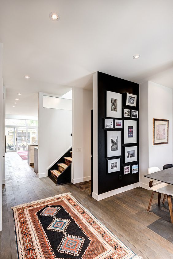 black accent wall with pictures