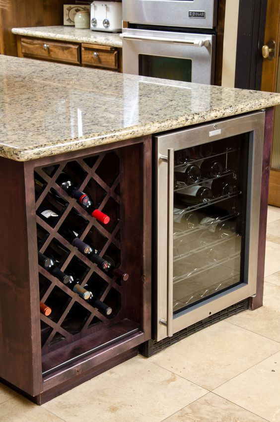 kitchen island with a wine cellar