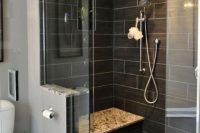 26 large black shower tiles