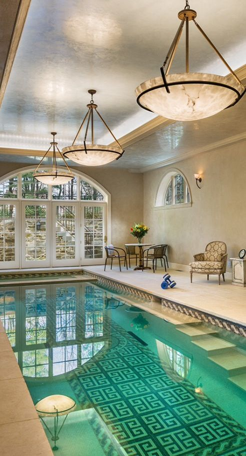 indoor pool with a tiled pattern on the bottom
