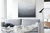 27 laconic Scandinavian room with just an oversized wall art