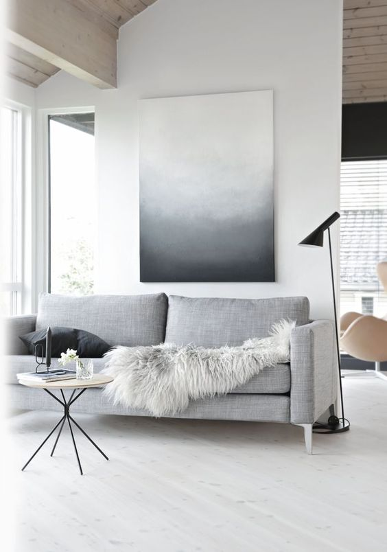 laconic Scandinavian room with just an oversized wall art