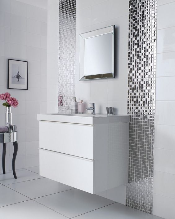 Spectacular mirror mosaic tiles lines along the vanity