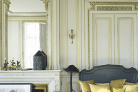 28 French-styled antique mirror over the fireplace