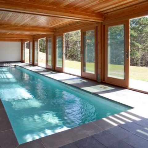 Picture of indoor swimming pool with doors that open to for Modern house designs with indoor pool