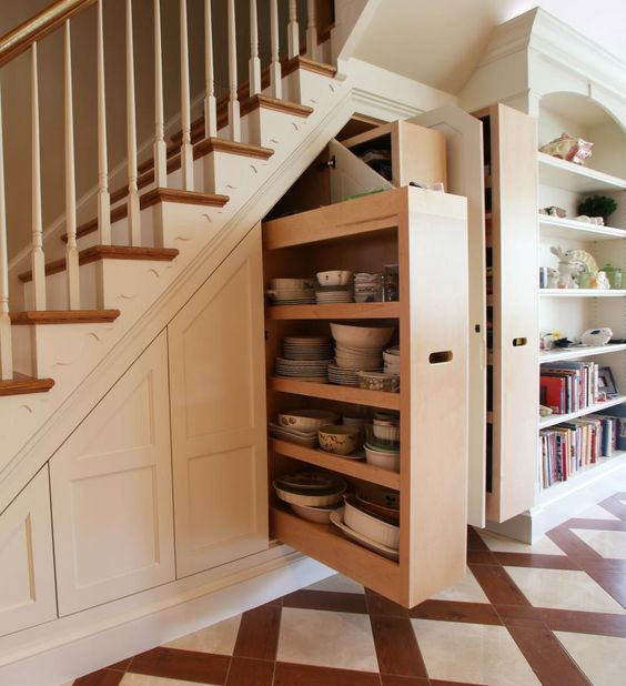 dishes and tableware storage under the stairs