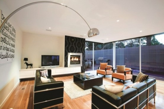 3 storey modern and luxurious house with timeless design for Timeless fireplace designs