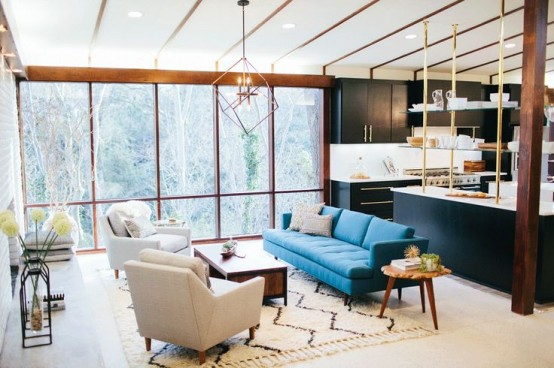 An interesting mid-century inspired interior where a living area and a kitchen are both located on the second floor.