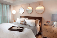 32 identical round mirrors above the bed