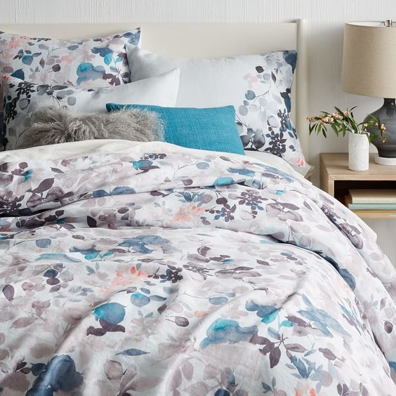 Watercolor is one of the huge trends popping up, and such bedding will set up a mood in the spring or summer