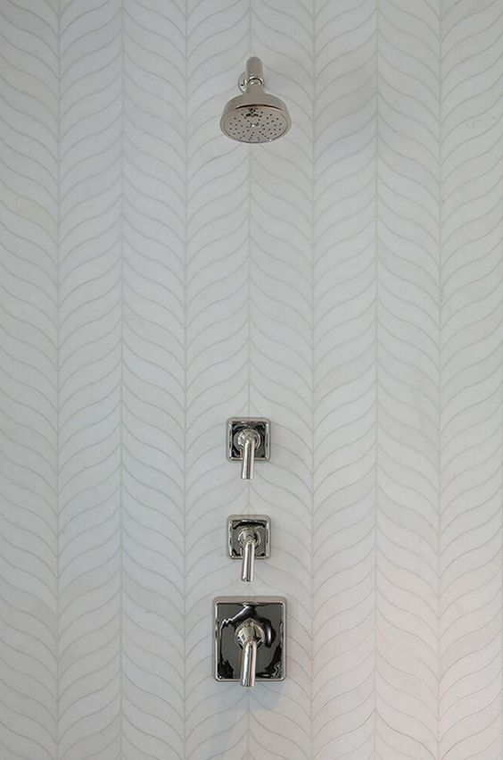 feather herringbone shower tiles