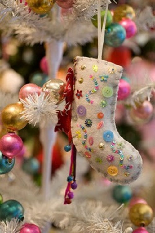 a neutral stocking with colorful beads and sequins is a lovely and bright Christmas ornament you can DIY