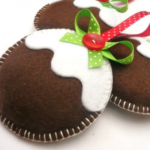a gingerbread man cookie Christmas ornament with glazing, with red and green decor is a lovely and whimsical idea