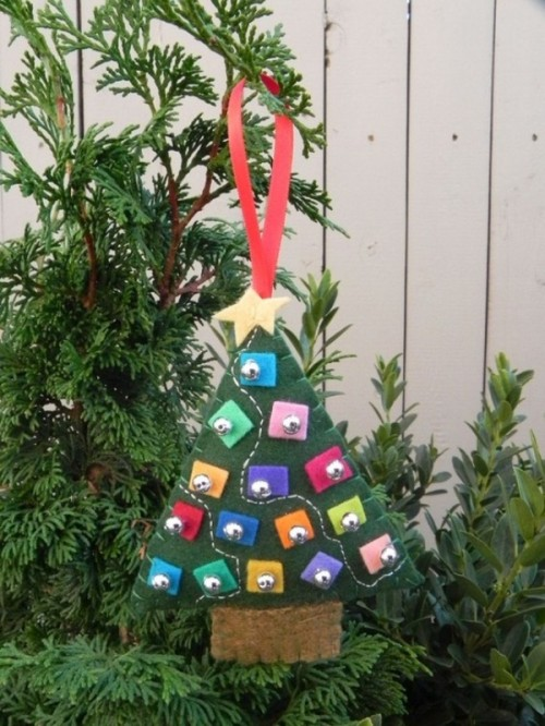 a green felt Christmas tree ornament with mini colroful felt pieces and beads is a lovely idea to try right now