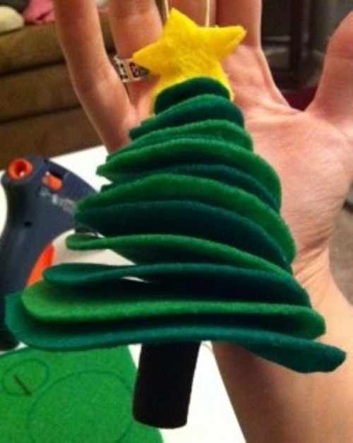 a green stacked felt Christmas tree with a star on top is a lovely idea with bold decor and chic