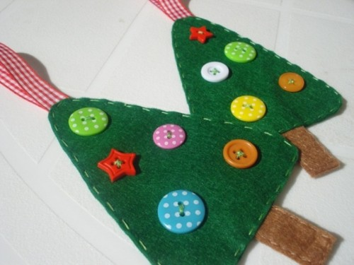 green felt Christmas ornaments with colorful buttons and red ribbons are lovely for decor and can be given as cute gifts, too