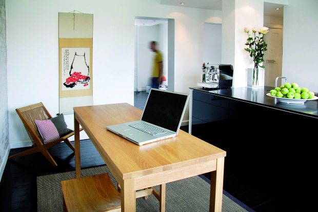 Square Meter Apartment With Completely Black Floors And Some Furniture