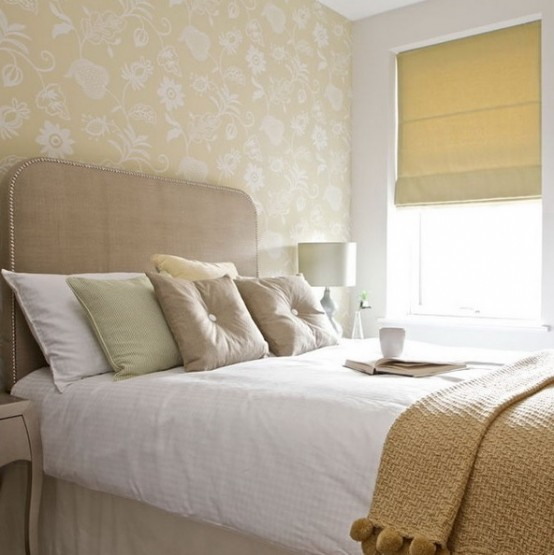 only neutrals used for decor of this bedroom, makes the small space look larger and cozier