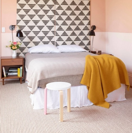 a soft pastel bedroom looks larrger thanks to geometric extended panels over the bed