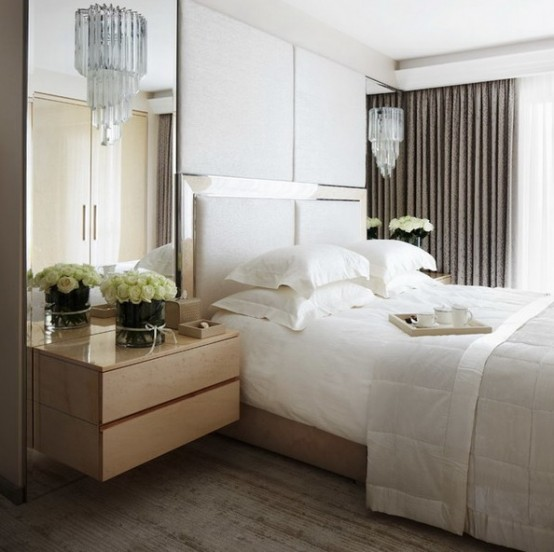 an oversized headboard plus upholstered panels over it plus mirrors on both sides of the bed make the bedroom larger and fresher